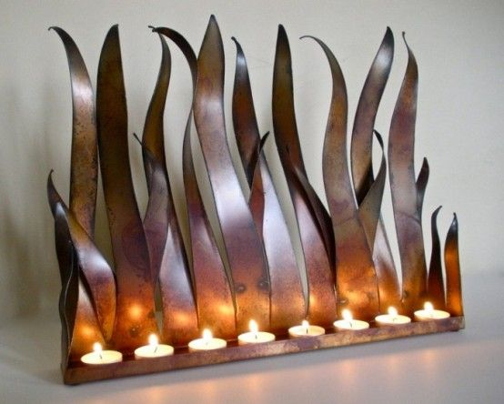 metal candle holder tabletop sculpture fireplace insert for tea lights or candles with copper patina this would also be great on a garden fence at