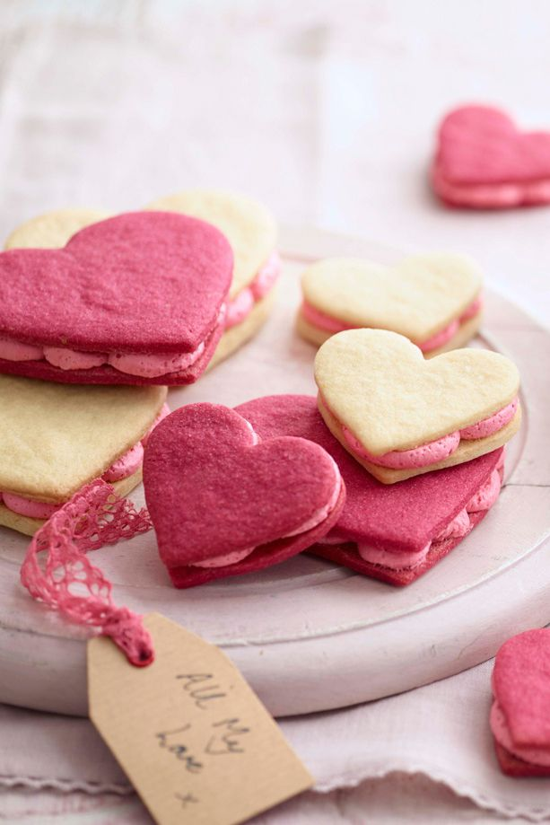 Say 'I love you' with these cute heart-shaped sandwich cookies, filled with a delicious pink buttercream. Your loved ones will be touched with this homemade, edible gift. | Tesco