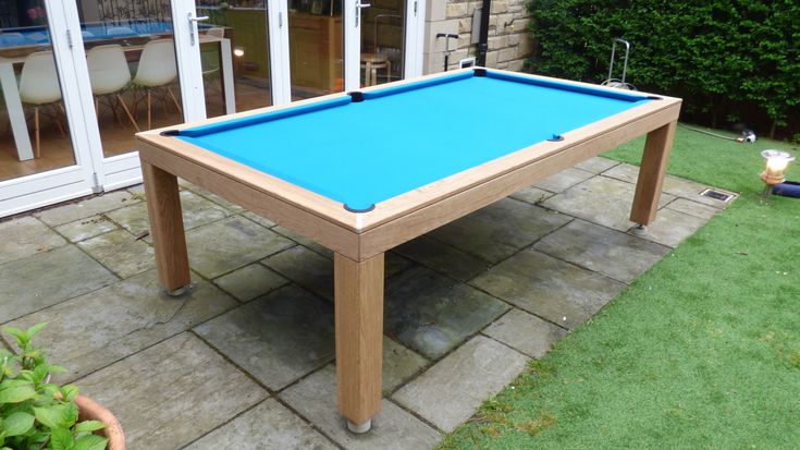 This is a 7' Outdoor Pool Table, made in our natural oak option (#32). This table has a Simonis Petroleum Blue Outdoor Cloth, which has been specifically designed to be used outdoors. Found at www.Luxury-Pool-Tables.co.uk
