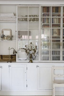 sideboard storage built using old window panes . Nina Hartman Sundgren's home . photo by Mari Eriksson . via Johanna Vintage