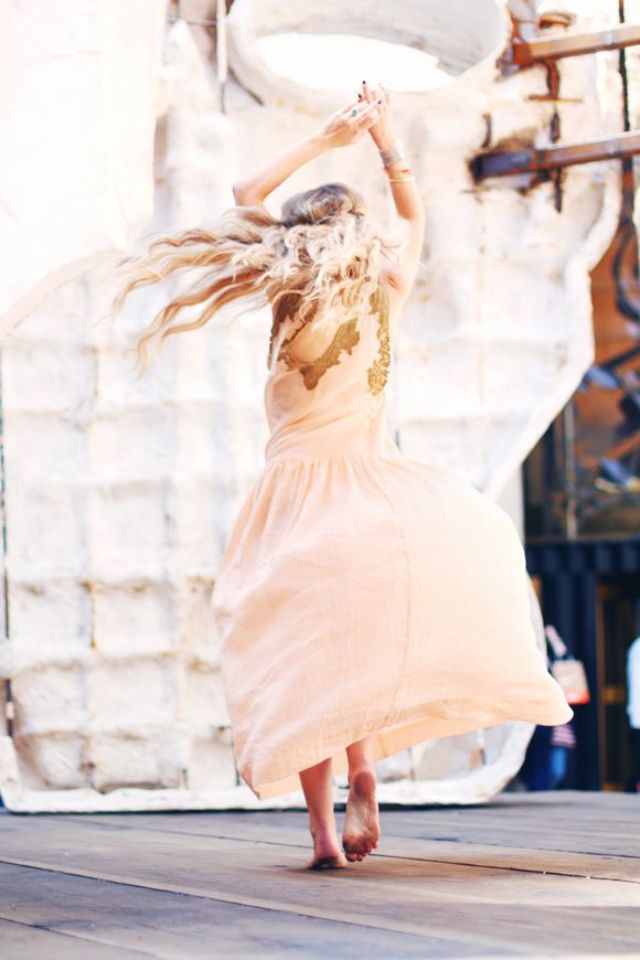 Artist Claire Bowen is dancing in the sunglight in a dress from @freepeople! (Level 1, South)