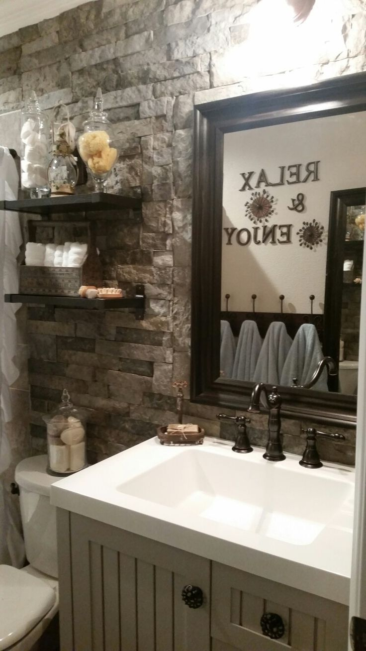 DIY Rustic Bathroom Makeover, using Lowe's AirStone as our accent wall. Ikea shelves and mirror, Martha Stewart vanity with upgraded knobs.