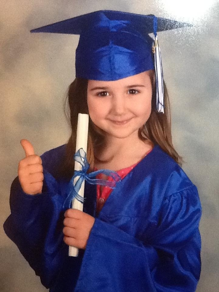 paige elizabeth graduated from kindergarten in nothing less than her jostens cap & gown.