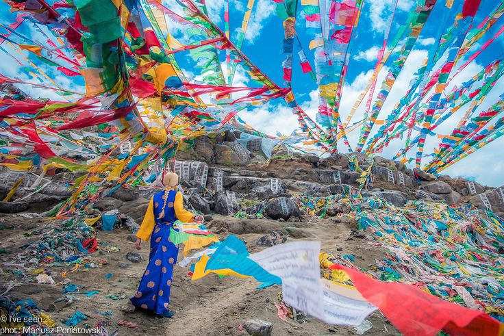 Thousands colourful prayer flags on the holy Tibetan  Mountain where Tibetans hang them to promote peace, wisdom, compassion and strength. Holy Mountain near Lhasa, Tibet, China