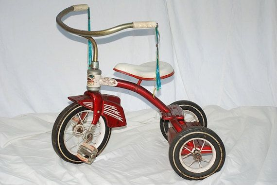 vintage 1960s tricycle - One child rode on the seat and the other child stood on the back.