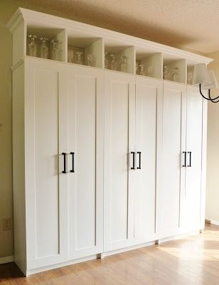 Youve GOT to check out this blog. High end looking DIYs at budget prices.   Tutorial on how to build a custom-looking storage cabinet from inexpensive assembled kitchen pantries.