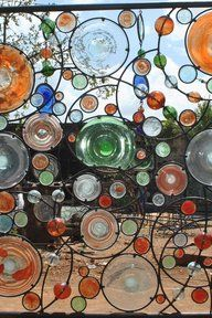 Wrought iron grill work with handblown glass - Anselm Studio in Kenya