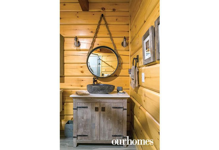 """This main floor vanity features a granite vessel sink.    See more of this home in """"Fifth Generation Legacy on Muskoka's Moon River"""" from OUR HOMES Muskoka Early Summer 2017: http://www.ourhomes.ca/articles/build/article/fifth-generation-legacy-on-muskokas-moon-river"""