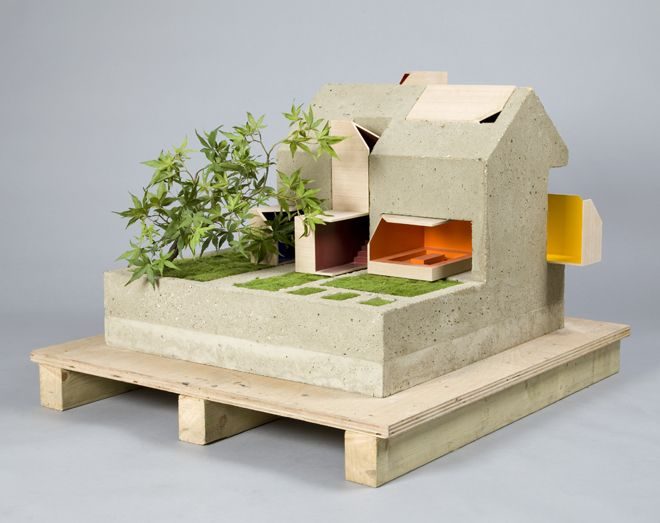 Coffey Architecture's Inside Out dollhouse is built out of concrete and includes a bonsai tree and herb garden. Image: Thomas Butler