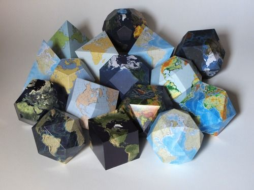 Assorted paper pseudoglobes, foldable map of earth.