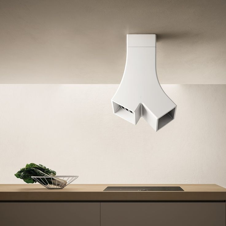 New kitchen hood from Elica YE, designed by  FABRIZIO CRISÀ. The use of Cristalplant, a material that is new in the kitchen hood production, allows soft lines and a directed double suction source.