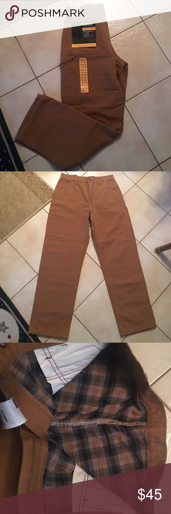 BRAND NEW Carhartt Men's Pants Brand new with tags! Mens carhartt work pants, size 34x32! They are flannel lined! With tags still on! WASHED DUCK WORK DUNGAREE-Flannel Lined Carhartt Pants Cargo