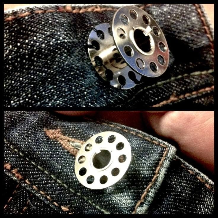 "StudioKat Designs  Here's a fantastic idea! Next time you lose the button from your jeans & you're stuck for a replacement, try stitching on a sewing machine bobbin! It's just the right size for the buttonhole & has the similar ""post"" ease of a jeans button."