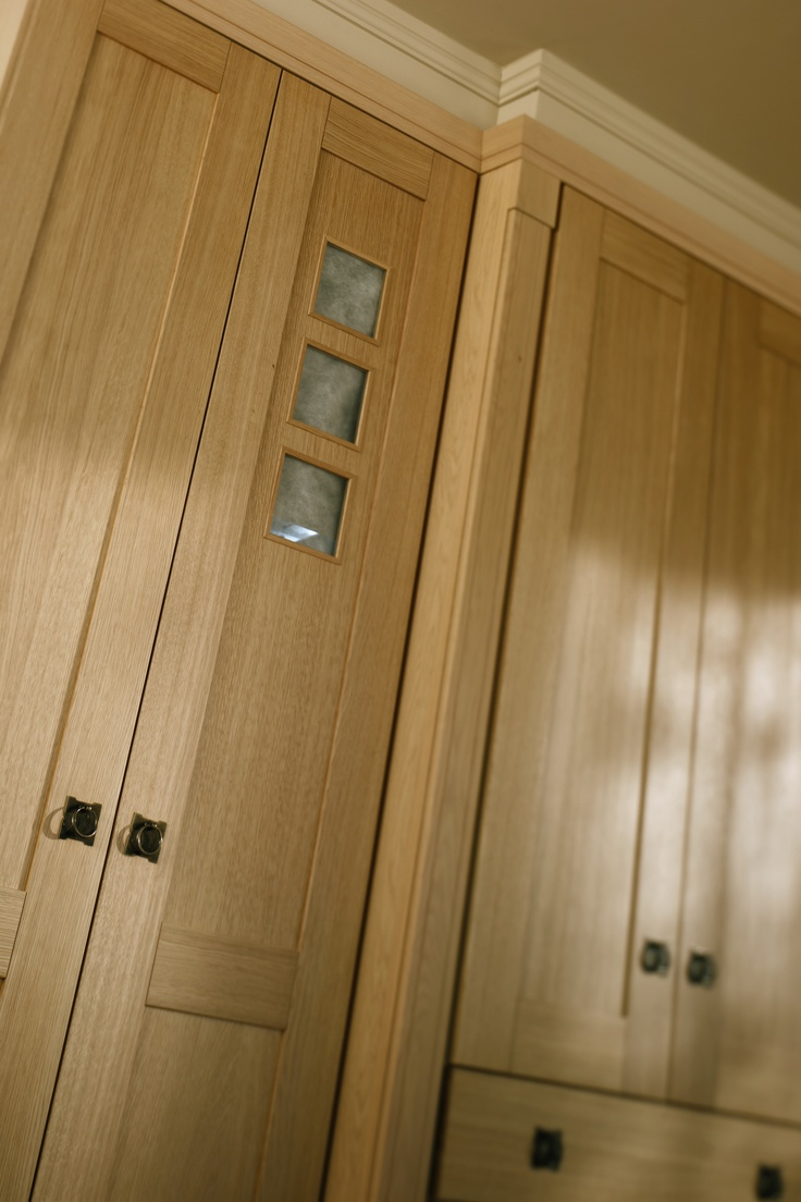 Shaker Solid Oak fitted wardrobe doors are manufactured from real oak. The frame of the doors are machined from solid oak and the inner door panels are a high quality genuine oak veneer. All drawer fronts are solid oak also. Take a look at the decorative feature doors, with three small beautifully crafted windows. Country and art deco combine to make any size of built-in bedroom wonderfully expressive.