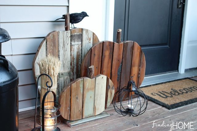 A+mix+of+stained+and+weathered+wood+scraps+makes+for+a+pretty+salvage-style+porch+display. Get+the+tutorial+at+Finding+Home+»  - GoodHousekeeping.com