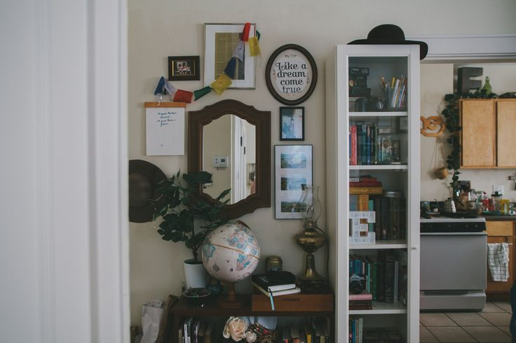 The apartment entryway features both new and vintage items. The globe is a thrift store find and the lamp is a hand-me-down from Emily's parents. It was originally a kerosene lamp, but Emily made it electric.
