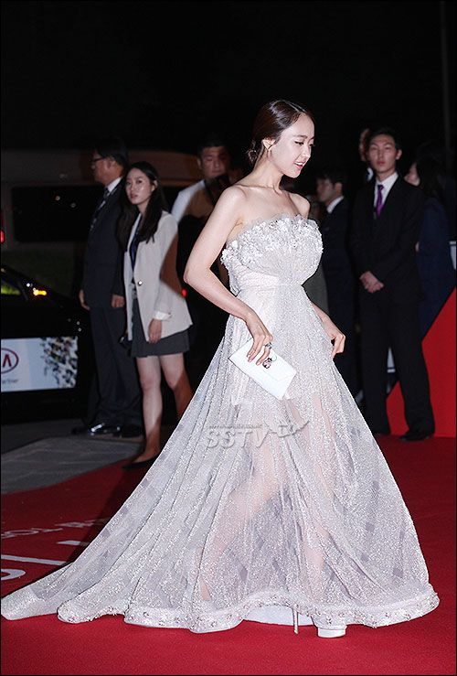 Korean actress Min-Jung Kim in an evening gown with Marja Kurki clutch