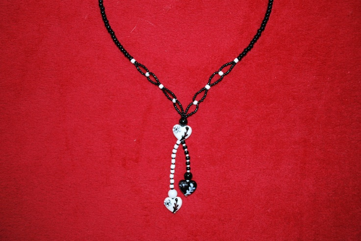 Made from seedbeads and lampworked heart shaped beads. (Many Hearts as One)