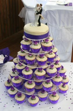 Cupcake cake...because it's cute and because it's ridiculous to have to pay someone to cut your cake!