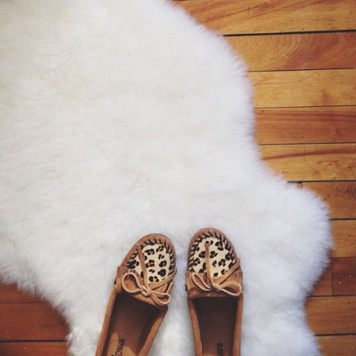 Love this furry rug and leopard moccasins.