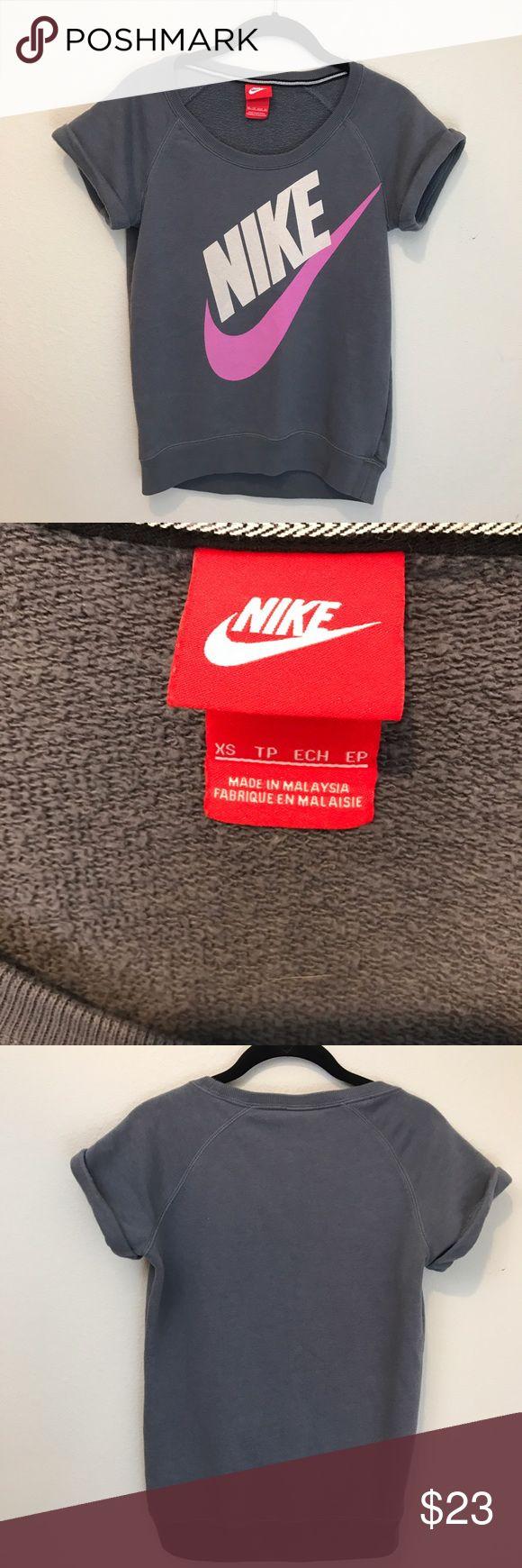 Nike Roll Sleeve Sweatshirt size XS Cute retro style Nike sweatshirt.  Short rolled sleeves in a medium gray color with a purple swoosh. Nike Tops Sweatshirts & Hoodies