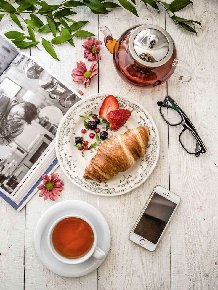 Cozy afternoon with croissant and tea by Gunel Farhadli