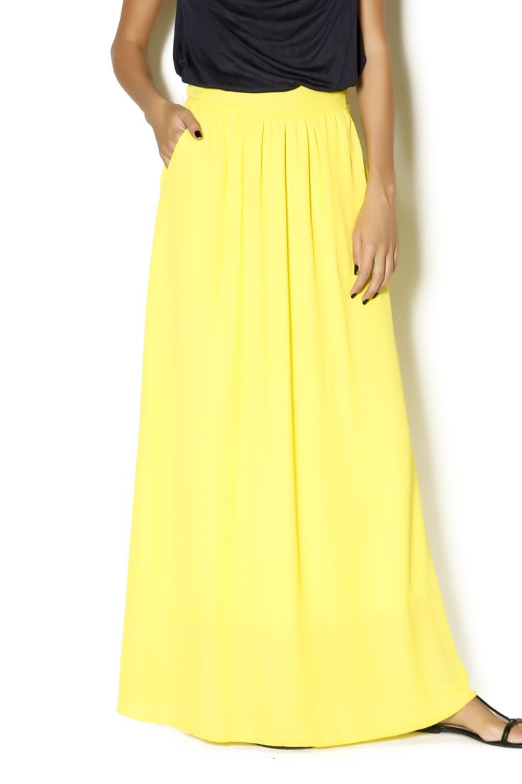 Yellow maxi skirt with an elastic band band and a partially lined skirt. This light and flowy skirt is great to wear during the Summer with crop tops.