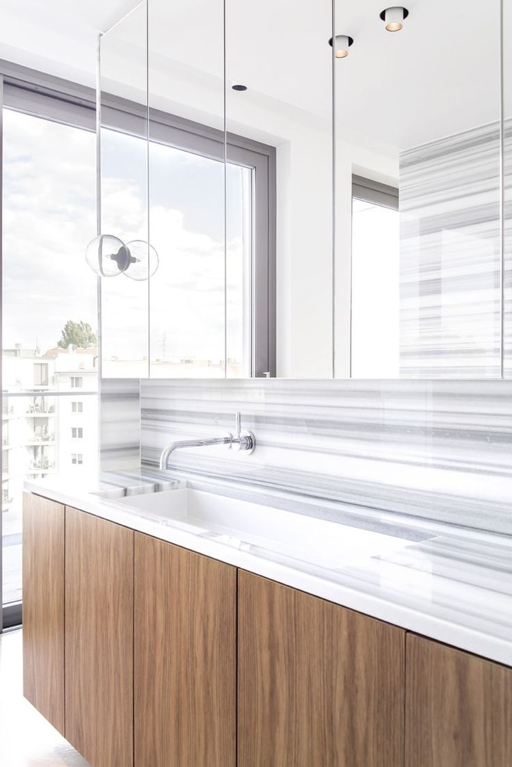 Contemporary italian kube kitchen with stylish lamp by snaidero