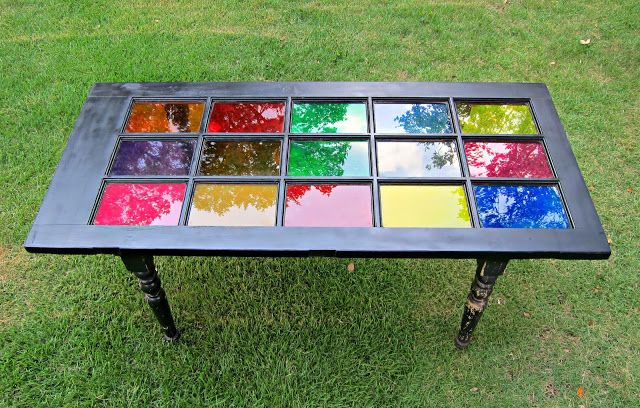 Take an old glass window, some legs from a broken table, favorite paint colors, and voila. . . a lovely, colorful, recycled table!