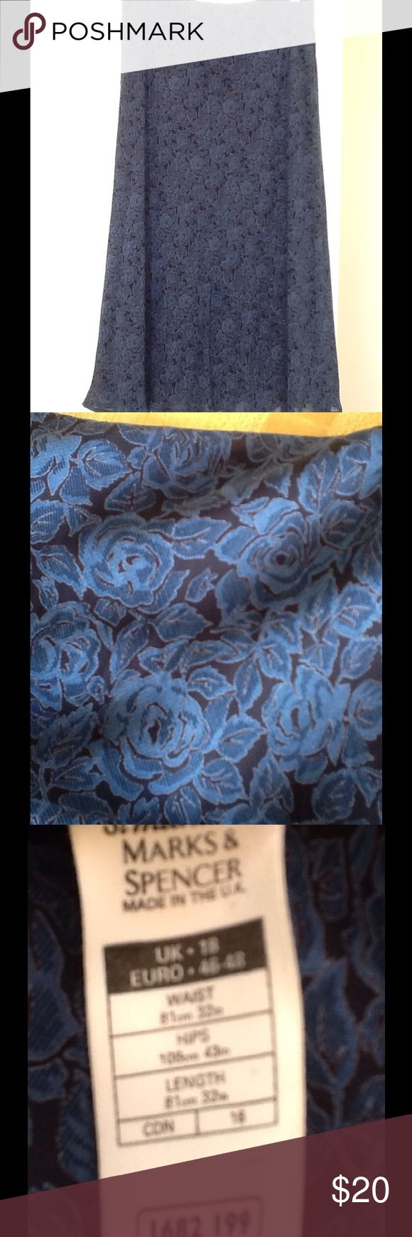 """Skirt Marks&Spencer, navy blue Sz 16W Here is a wonderful dress skirt made of 100% Viscose. Fully lined, elasticize do waist. In excellent condition. No stains and no rips. Size 16W. Made in the UK. Marks & Spencer Brand. The waist measures 34""""; hips 43""""; length 29"""". Lightweight and classy. Floral print, navy blue color. A-shaped or princess. Skirts A-Line or Full"""