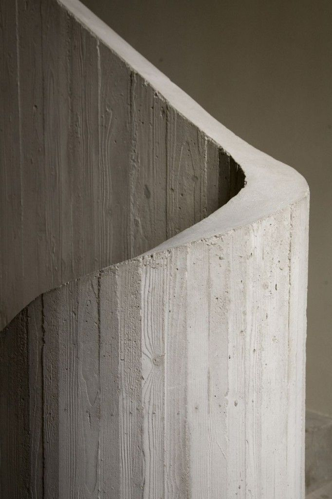 A board-formed concrete staircase in the Graanmarkt 13 concept store by Vincent Van Duysen.