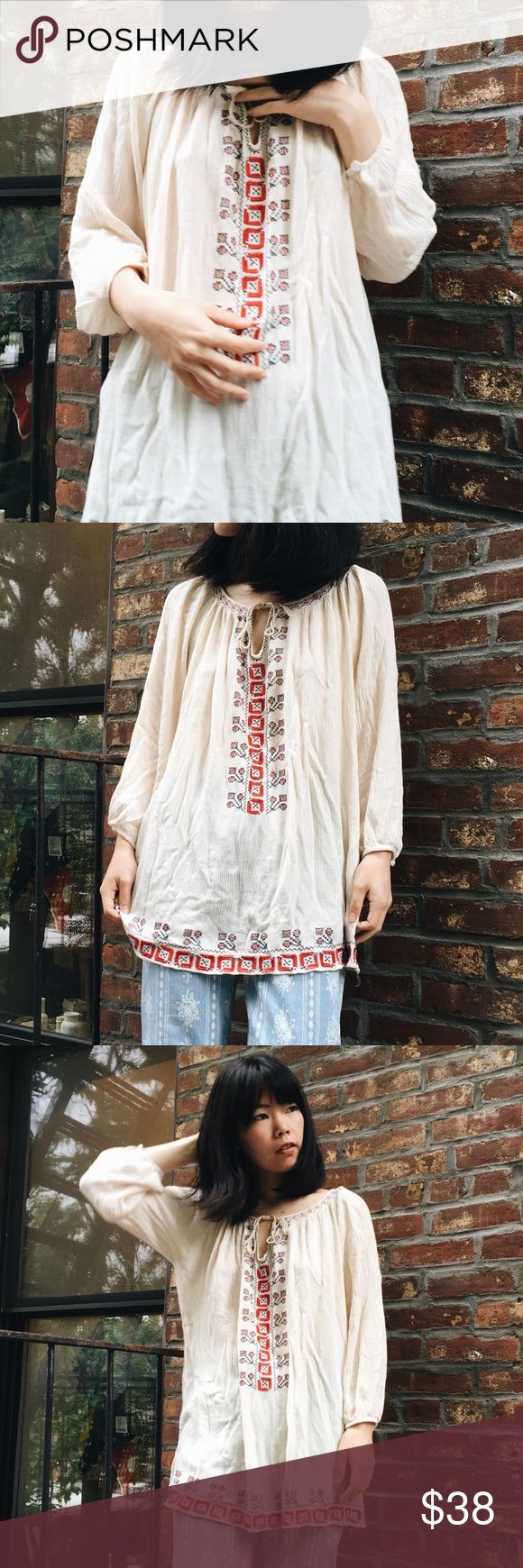 """Vintage bohemian embroidered flea cream Vintage bohemian embroidered flea cream white tunic / top  So cute embroidery in front and on the bottom!!💕 perfect for summer 💕 • fits like small to medium (model is 5'3"""" and small size) • in great condition!  #vintage #floral #maxidress #zara #topshop #asos #uo #andotgerstories #antholopologie #gap #levis #freepeople #chic #elegant #boho #unique Tops Tunics"""