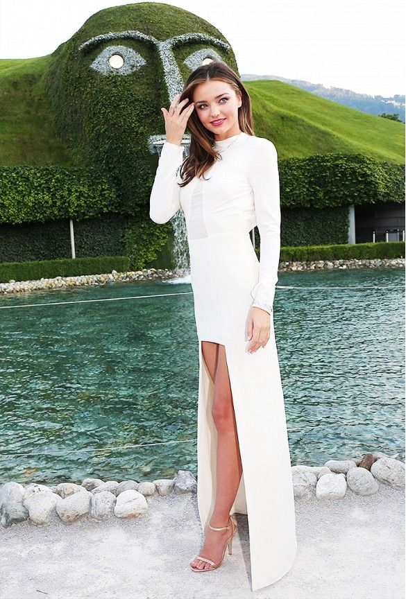 Miranda Kerr wears a white high-low gown with heeled sandals at Swarovski HQ in Austrai
