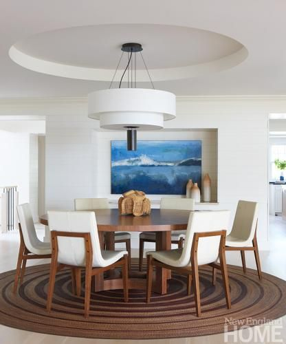 A Round Dining Room Table Provides Convivial Spot For Enjoying Meal Interior Design