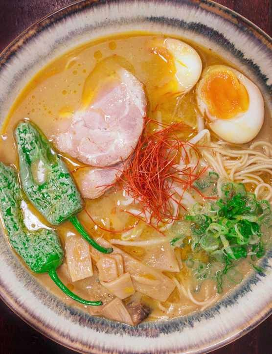 This spicy miso ramen is from the hip Japanese ramen restaurant Bone Daddies. It takes a little time but the result is worth it: rich pork broth with noodles and exotic ingredients. Prepare and marinade the eggs and the meat the night before for best results.
