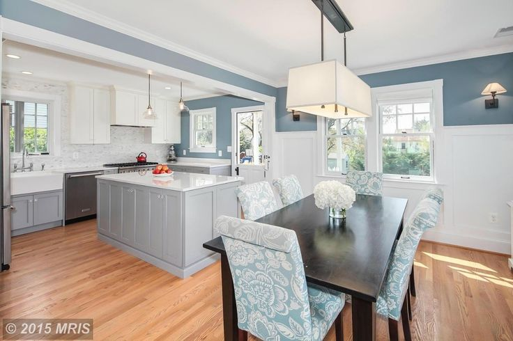Cottage Kitchen with Flat panel cabinets, Custom hood, Wainscoting, Farmhouse sink, Breakfast nook, Complex Marble, Flush