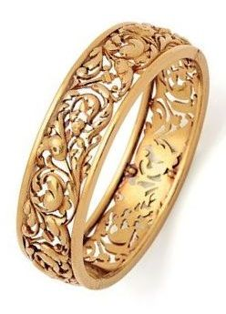 An Antique Gold Bangle Bracelet, Leon Gariod, France, circa 1890. The oval openwork hoop carved in high relief with floral and foliate motifs, in 18k gold, interior circumference 7 ins, with maker's mark for Leon Gariod.