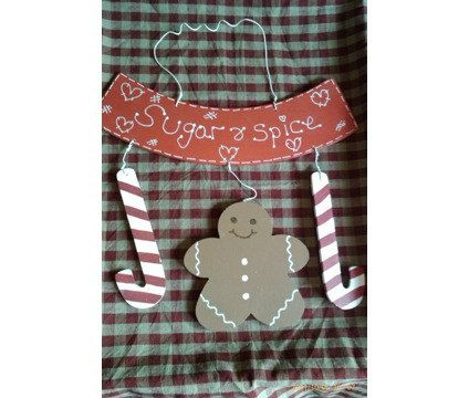 Christmas gingerbread man plaque, lovely little gingerbread man and two candy canes hang from an arched plaque that reads sugar and spice, all hand painted and sealed, would make a lovely gift. Measures 12in from top of wire hanger x 9in.   Shop this product here: http://spreesy.com/Gingerbread/37   Shop all of our products at http://spreesy.com/Gingerbread      Pinterest selling powered by Spreesy.com