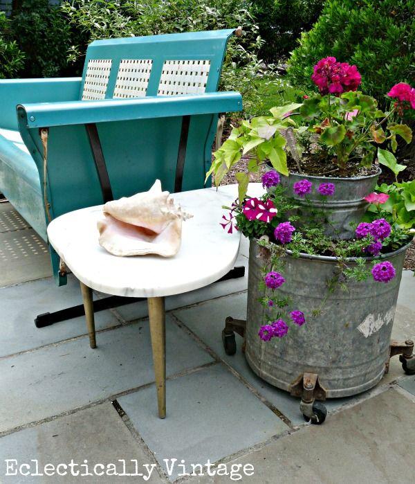 Vintage porch glider and mop bucket planter: Gardens Ideas, Unique Planters, Buckets Planters, Outdoor Patio, Mop Buckets, Gardens Container, Porches Gliders, Front Porches, Eclectic Vintage
