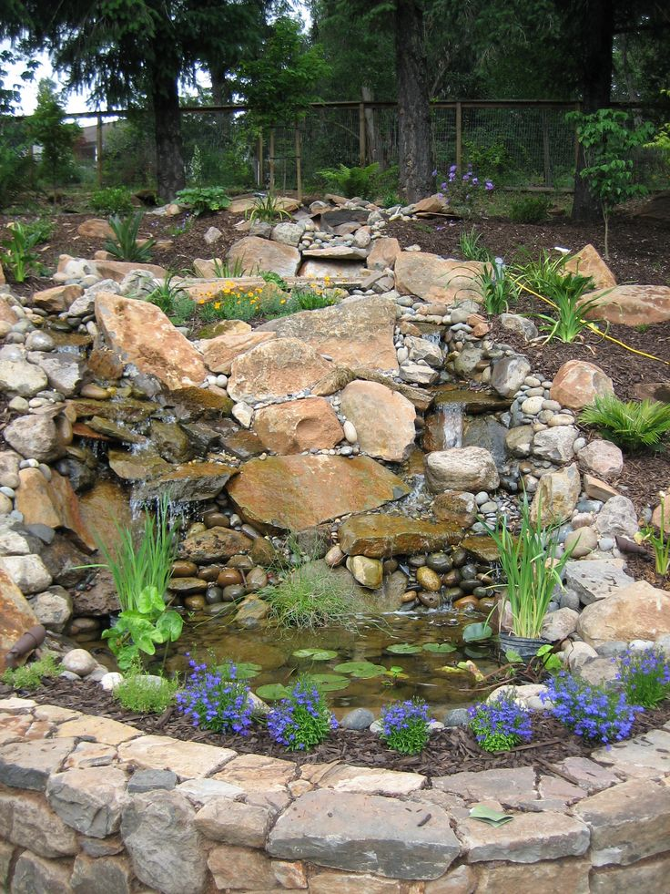 Backyard waterfall made from river rock and slate very for Rock waterfall