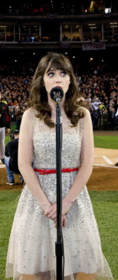 Zooey Deschanel singing the National Anthem at a pro baseball game. There's a video on YouTube. Pull it up!