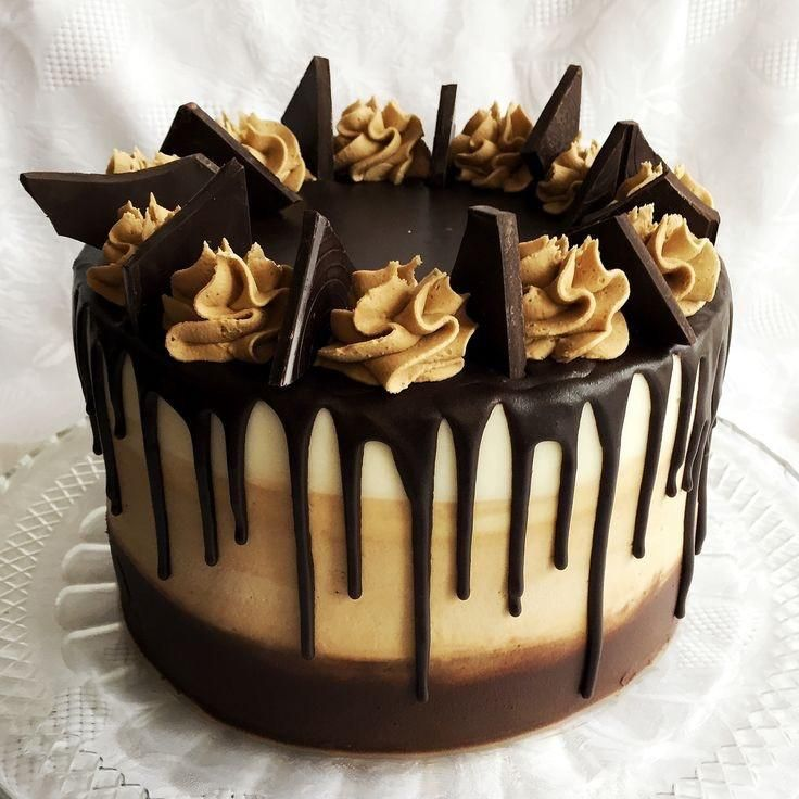 San Diego Bakery. Gourmet chocolate and peanut butter drip cake. vegan cake available. crunch peanut frosting, pretzels, caramel all layered between chocolate cake.