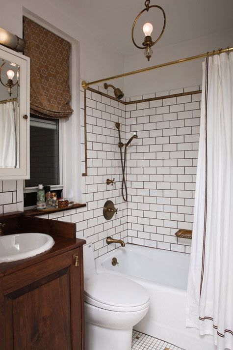 Dark wood goes beautifully in a white bathroom (note brass fittings though!)