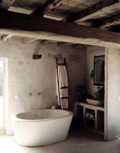 stone and natural shapes...love how it looks like the bath tub is made out of the same material as the walls