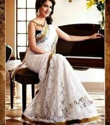 Buy White plain Net Bolly Wood saree with blouse Online