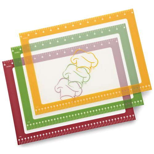 """Flexible Cutting Mats - The Pampered Chef®  Perfect for light prep tasks like cutting vegetables and seasoning meats. Silicone backing grips countertops. Thin, flexible material lets you funnel ingredients into recipes. Mats include measure marks. Set of three in red, orange and green. Dishwasher-safe. 11"""" x 15""""."""