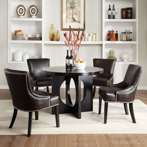 This More Modern Dining Room Set Combines Comfort With Contemporary Design.  The Nail Head