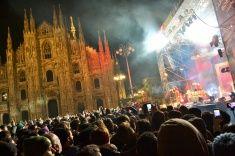 Nadia Mikushova. People watching New Year concert by night in Milan. stock photo