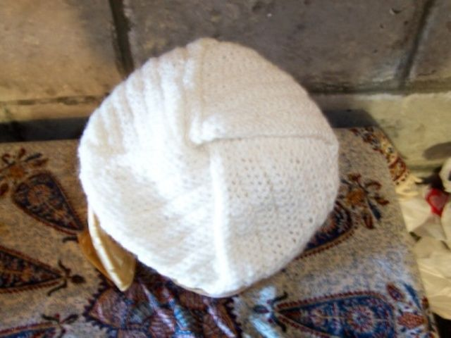 Naalbinding... hat made in the style of the hat found in the archaelogical dig in the Tarim Basin.