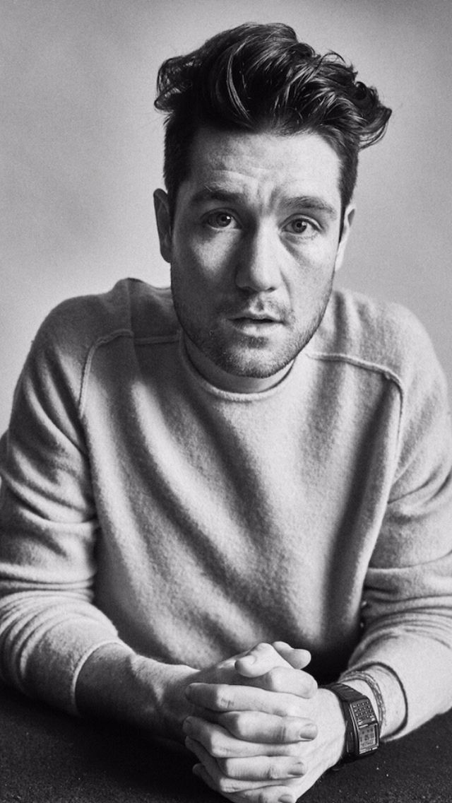 Dan Smith, done up in black and white, wearing his calculator watch